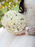 Wedding bouquet. Of roses in hands of the bride Royalty Free Stock Image