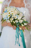 Wedding bouquet. In hands of the bride Stock Images