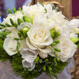Wedding bouquet. Close-up of a wedding bouquet of a white roses with pearls Royalty Free Stock Image