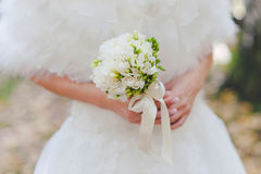 Wedding bouquet. In hands of the bride Royalty Free Stock Photos