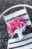 Wedding bouquet. On a metallic chair Stock Photography