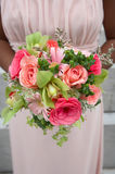 Wedding bouquet. Held by African-American bridesmaid Royalty Free Stock Photography
