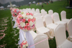 Wedding bouquet. The wedding holding flowers on the green grass Stock Image