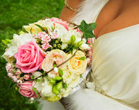 Wedding bouquet. The bride holds about the bust beautiful Wedding bouquet royalty free stock photography