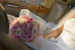 Wedding Bouquet. A picture of a bride with a bouquet in a Bentley Royalty Free Stock Images