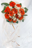 Wedding bouquet. Wedding bouqet from red roses in bride's hands stock photography