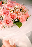 Wedding bouquet. Wedding bouqet from pink roses in bride's hands stock photography