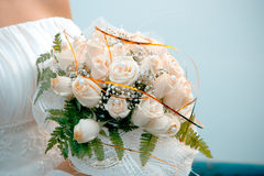 Wedding bouquet. Wedding bouqet from white roses in bride's hands royalty free stock photos