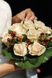 Wedding bouquet. Bride (face not visible) holding flower bouquet in hands Royalty Free Stock Images