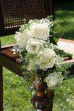 Wedding bouquet. On wooden chair Royalty Free Stock Images
