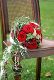 Wedding bouquet. Red Wedding bouquet on wooden chair Stock Image
