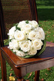 Wedding bouquet. White Wedding bouquet on wooden chair Royalty Free Stock Photo