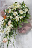 Wedding bouquet. Wedding bouqet from white roses in bride's hands stock photo