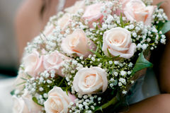 Wedding bouquet. Wedding bouqet from pastel pink roses in bride's hands stock photos