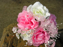 Wedding bouquet. A wedding bouquet of artificial flowers outside on a sandstone rock Stock Photo