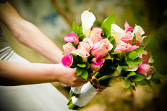Wedding bouquet. Bride holding a wedding bouquet Royalty Free Stock Images
