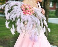 Wedding bouquet. Bride is holding flower bouqet at the wedding reception stock photos