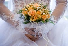 Wedding bouquet. The bride holds a bouquet of yellow roses Royalty Free Stock Image