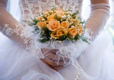 Wedding bouquet. The bride holds a bouquet of yellow roses Stock Images