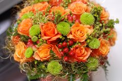 Wedding bouquet. With orange roses and red berries Royalty Free Stock Photos