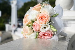 Wedding bouquet. The wedding bouquet of light roses is on a stoun Stock Image