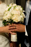 Wedding bouquet. The groom and the bride holding a wedding bouquet, close up Stock Photography