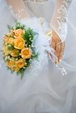 Wedding bouquet. The bride holds a bouquet of yellow roses Stock Photo