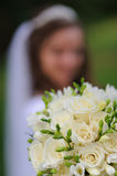 Wedding bouquet. The bride holds wedding bouquet - close up Royalty Free Stock Photography