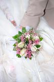 Wedding bouquet. The groom and the bride hold a wedding bouquet Stock Images