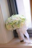 Wedding bouquet. Beige wedding bouquet beside the window Royalty Free Stock Photo