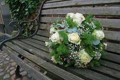 Wedding bouquet. On a bench Stock Photos