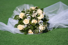 Wedding bouquet. The wedding bouquet lays on a grass Stock Photo