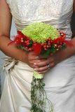 Wedding bouquet. Flowers in her hand Royalty Free Stock Image