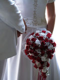 Wedding bouquet. A wedding bouquet with white dress and white tuxedo Royalty Free Stock Images