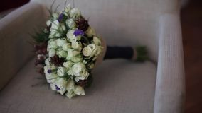 Wedding bouquet on the armchair decoration, romance, background, floral, green stock video footage