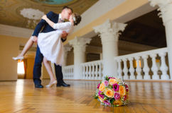 Wedding bouquet on background of dancing newlyweds Stock Images