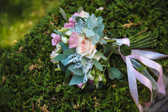 Wedding bouquet on background of green grass Royalty Free Stock Image