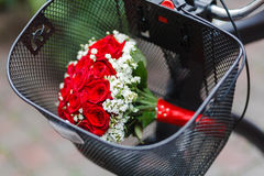 Wedding bouquet in the basket of bicycle Royalty Free Stock Photography