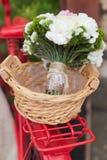 Wedding bouquet into basket Royalty Free Stock Photos