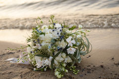 Wedding bouquet on the beach. At sunset royalty free stock photos