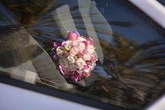 Wedding bouquet . Beautiful bouquet of different colors in the car royalty free stock image