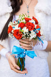 Wedding bouquet. Beautiful wedding bouquet in hands of bride Royalty Free Stock Images