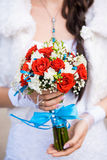 Wedding bouquet. Beautiful wedding bouquet in hands of bride Royalty Free Stock Photos