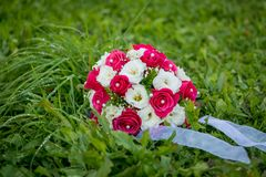 Wedding bouquet. Beautiful wedding bouquet on the natural background Royalty Free Stock Image