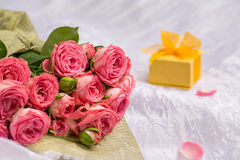 Wedding bouquet of beautiful pink roses with gift Stock Images
