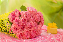 Wedding bouquet of beautiful pink roses with gift box for jewelry. Royalty Free Stock Photo