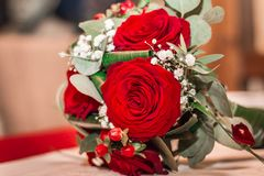 Wedding bouquet. Beautiful wedding bouquet with red roses. Greeting card for 8 March International Women`s Day. Close up Stock Images