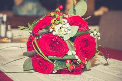 Wedding bouquet. Beautiful wedding bouquet with red roses. Greeting card for 8 March International Women`s Day. Vintage filter effect. Close up Stock Photography
