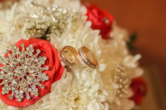 Wedding bouquet of beautiful roses and rings Stock Images