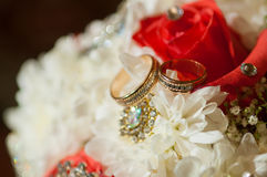 Wedding bouquet of beautiful roses and rings Royalty Free Stock Photo